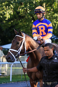 Uncle Mo (Indian Charlie) and jockey John Velazquez go to the post for the Champagne Stakes at Belmont Park 10/9/10 JH.