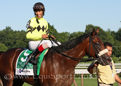 A Little Warm (Stormin Fever) and jockey John Velazquez return after winning the Jim Dandy Stakes at Saratoga Racecourse 7/31/10 JH.