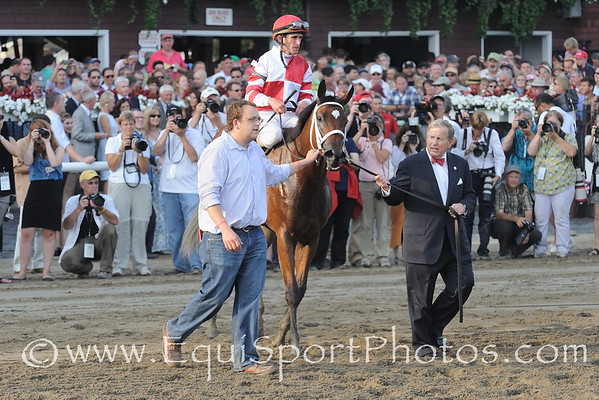 Havre de Grace and Ramon Dominguez are led to The Woodward Winner's Circle by owner Rick Porter