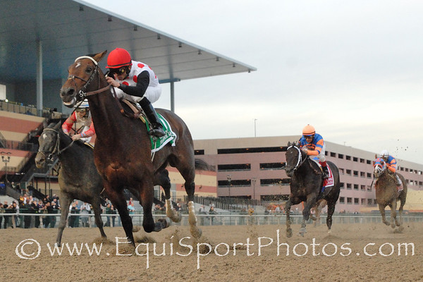 To Honor and Serve (Bernardini) and jockey Rajiv Maragh win the Gr I Cigar Mile at Aqueduct 11/26/11 for trainer Bill Mott and owner Live Oak Plantation.