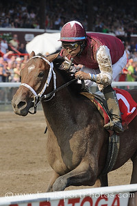 Alpha, Alan Garcia up, gains maiden win at first asking on Woodward Day.