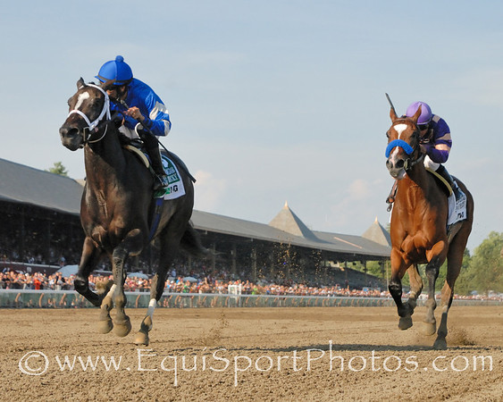 It's Tricky and Eddie Castro (left) win The Coaching Club American Oaks over Plum Pretty. Photo credit: Bud Morton/EquiSport Photos.