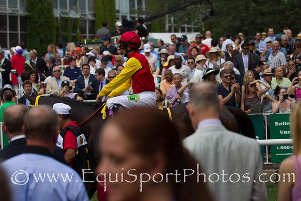 The Paddock was shoulder to shoulder as connections watched their horses saddled.  Trinninberg  with Willie Martinez aboard leaves the paddock on the way to winning the 28th running of The Woody Stephens (Gr.II).