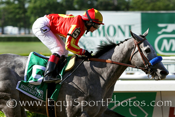Midnight Lucky (Midnight Lute) and jockey Rosie Napravnik win the Acorn Stakes (Gr I) at Belmont Racetrack 5/27/13. Trainer: Bob Baffert. Owner: Mike Pegram