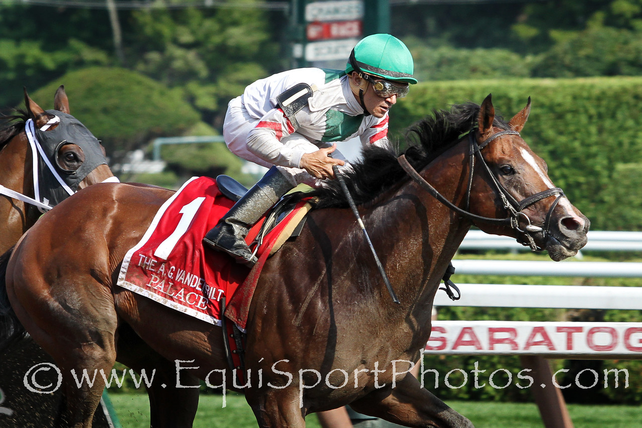 Palace (City Zip) and jockey Cornelio Velasquez win the Alfred G. Vanderbilt (Gr I) at Saratoga Racecourse 8/2/14. Trainer: Linda Rice. Owner: Antonino Miuccio