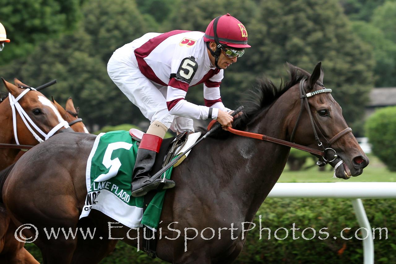 Crown Queen (Smart Strike) and jockey John Velazquez win the Lake Placid (Gr II) at Saratoga Racecourse 8/16/14. Trainer: Bill Mott. Owner: Besilu Stables