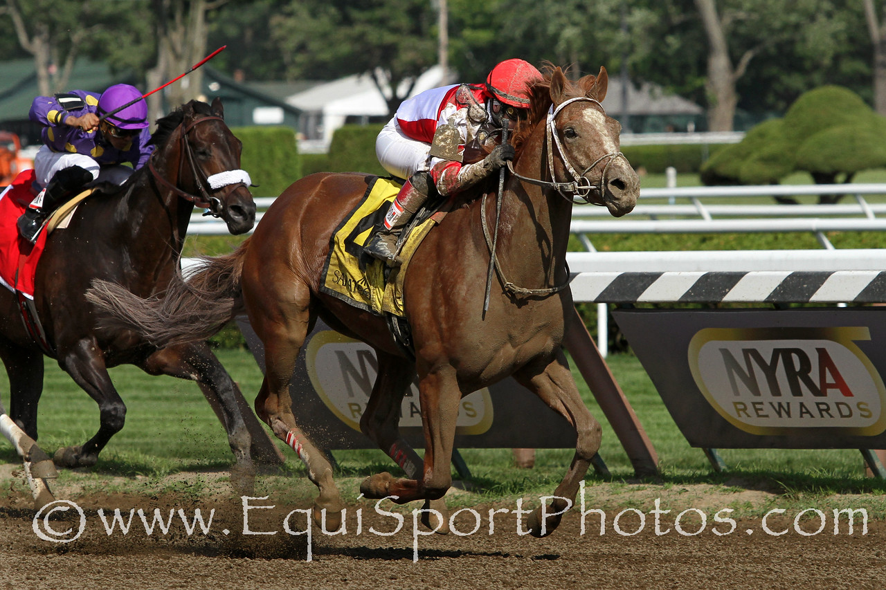 Coup de Grace (Tapit) and jockey Rosie Napravnik win the Amsterdam (Gr II) at Saratoga Racecourse 7/26/14. Trainer: Larry Jones. Owner: Fox Hill Farm