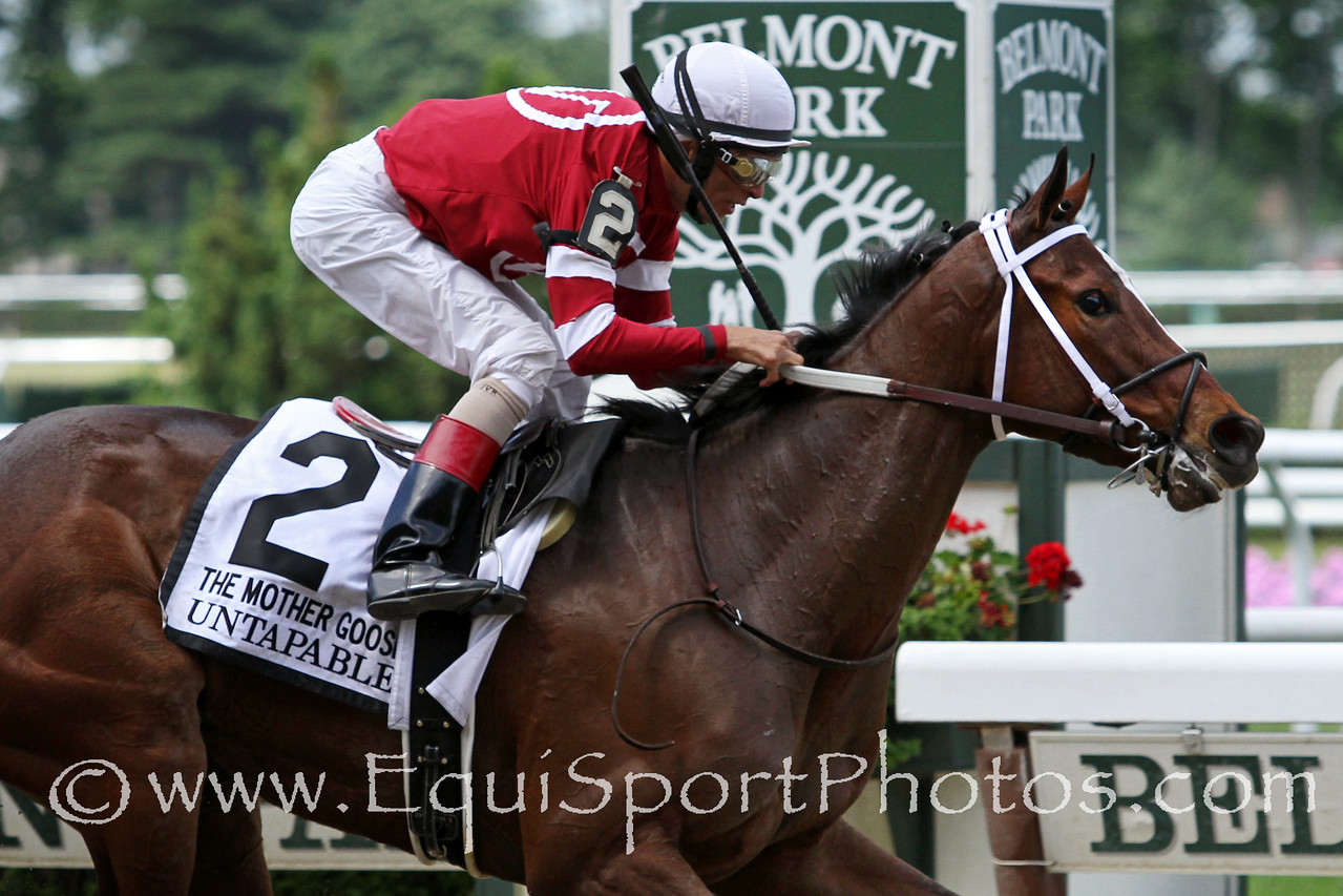 Untapable (Tapit) and jockey John Velazquez win the Mother Goose (Gr I) at Belmont Park 6/28/14. Trainer: Steve Asmussen. Owner: Ron Winchell