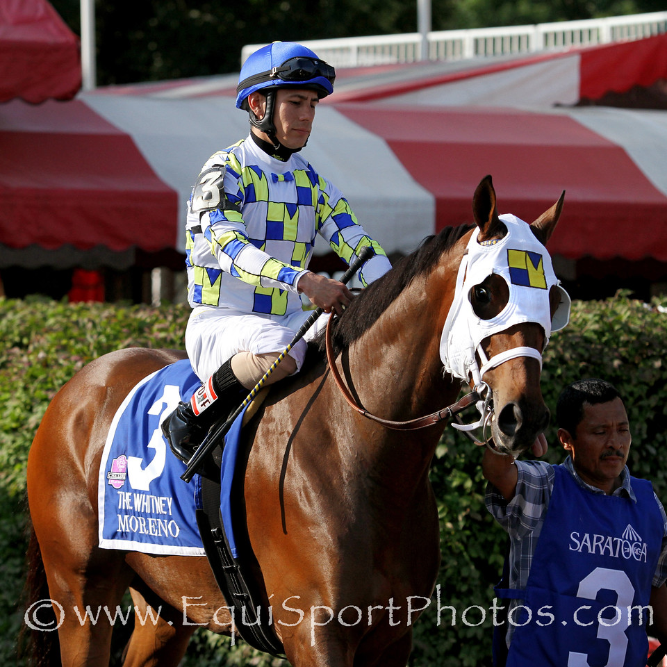 Moreno (Ghostzapper) and jockey Junior Alvarado win the Whitney (Gr I) at Saratoga Racecourse 8/2/14. Trainer: Eric Guillot. Owner: Southern Equine Stables