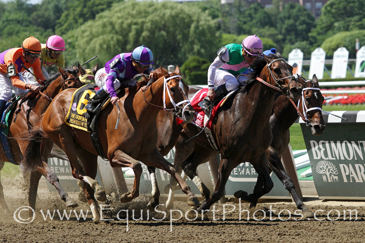 Close Hatches (First Defense) and jockey Joel Rosario win the Ogden Phipps (Gr I) at Belmont Park 6/7/14. Trainer: William Mott. Owner: Juddmonte Farms