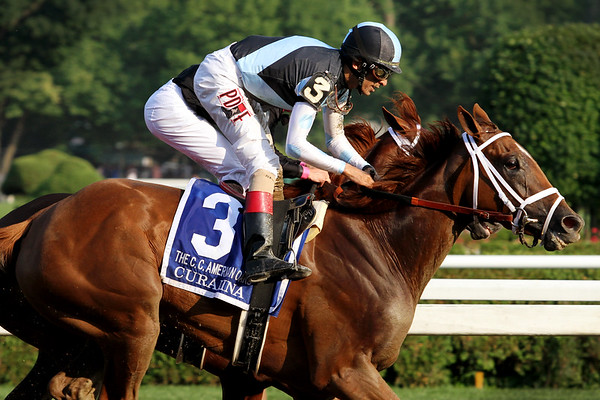 Curalina (Curlin) and jockey John Velazquez win the Coaching Club American Oaks (Gr I) via DQ at Saratoga Racecourse 7/26/15. Trainer: Todd Pletcher. Owner: Eclipse Thoroughbred Partners