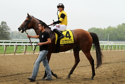 Twilight Eclipse (Purim) and jockey Javier Castellano win the Man O'War (Gr I) at Belmont Park 5/9/15. Trainer: Tom Albertrani. Owner: West Point Thoroughbreds