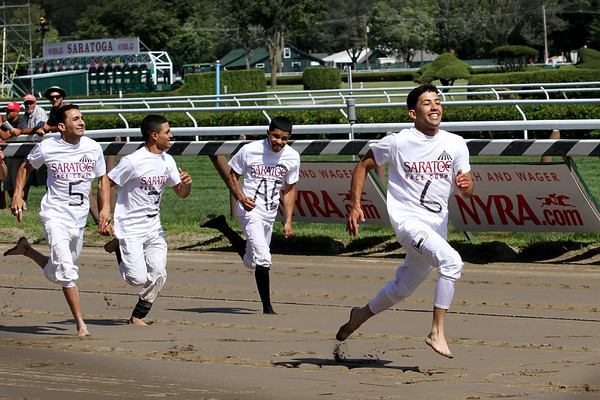 Angel Cruz wins the Jockey Foot Race benefitting the Permanently Disabled Jockeys Fund at Saratoga Racecourse 8/1/15.