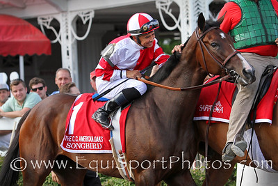 Songbird (Medaglia d'Oro) and jockey Mike Smith win the Coaching Club American Oaks (Gr I) at Saratoga Racecourse 7/24/16. Trainer: Jerry Hollendorfer. Owner: Fox Hill Farms, Inc.
