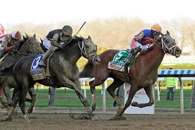 Bourbonic (Bernardini) and jockey Kendrick Carmouche win the Wood Memorial (Gr II) at Aqueduct Racetrack 4/3/21. Trainer: Todd Pletcher. Owner: Calumet Farm
