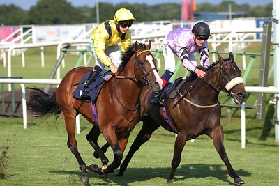 Zaammit and Jason Hart [yellow colours] wins the visit attheraces.com Maiden Stakes at Doncaster from Bridgetown [hooped sleeves] and Helmora. 26/6/2021 Pic Steve Davies