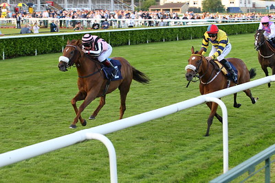Lady Reset and Laura Pearson win the Follow At The Races On Twitter Fillies Handicap at Doncaster from Casilli. 26/6/2021 Pic Steve Davies
