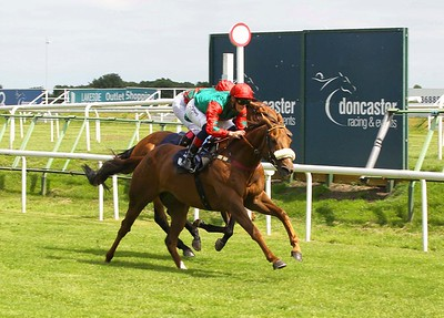 Jawwaal and Callum Rodriquez win the Download The Free At The Races App Handicap at Doncaster. 13/6/2021 Pic Steve Davies