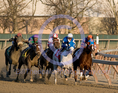The field for the Hill and Dale Cigar Mile races around the far turn at Aqueduct Race Track.  Led by Driven by Success (orange cap) and Vineyard Haven (white cap) followed closely by Bribon (purple) on the outside of the eventual winner Kodiak Kowboy (white and red)followed by Vacation (red) and Pyro (blue).  The Cigar Mile is the final Grade 1 race run in New York.