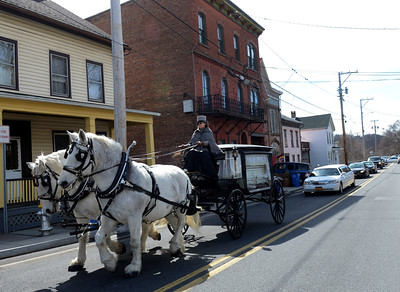 Tania Barricklo-Daily Freeman    A funeral procession led by a horse drawn hearse carrying Kingston resident Gwendolyn J. Boler- Mollette,56, makes its way up Abeel St. in Kingston Thursday afternoon on its way to Wiltwyck Cemetery.The funeral service was held at New Progressive Baptist Church on Hone St.Boler- Mollette was known for fostering and providing a home for many children.The horses and carriage were from Loon Meadow Farm in Greenfield Center, N.Y.