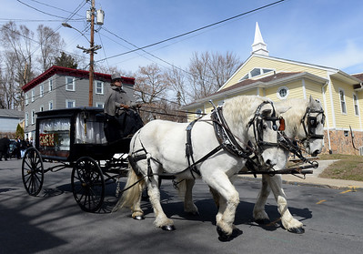 Tania Barricklo-Daily Freeman    A funeral procession led by a horse- drawn hearse carrying Kingston resident Gwendolyn J. Boler- Mollette,56, passes in front of the New Progressive Baptist Church on Hone St. in Kingston where a service was held Thursday afternoon.The procession made its way to Wiltwyck Cemetery where she was interred.Boler- Mollette was known for fostering and providing a home for many children.The horses and carriage were from Loon Meadow Farm in Greenfield Center, N.Y.