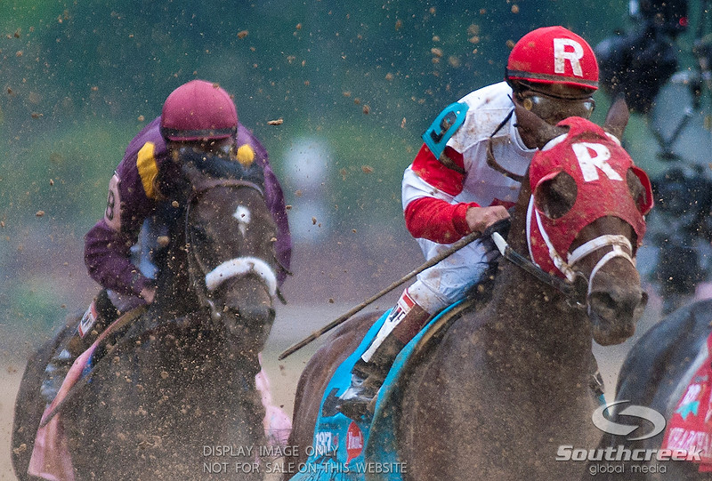 Jockey Javier Castellano (9) aboard Derby Kitten can't see very well being in the rear during the 137th running of the Kentucky Derby  at Church Hill Downs in Louisville,KY. Animal Kingdom won in front of a record crowd of 164,858.