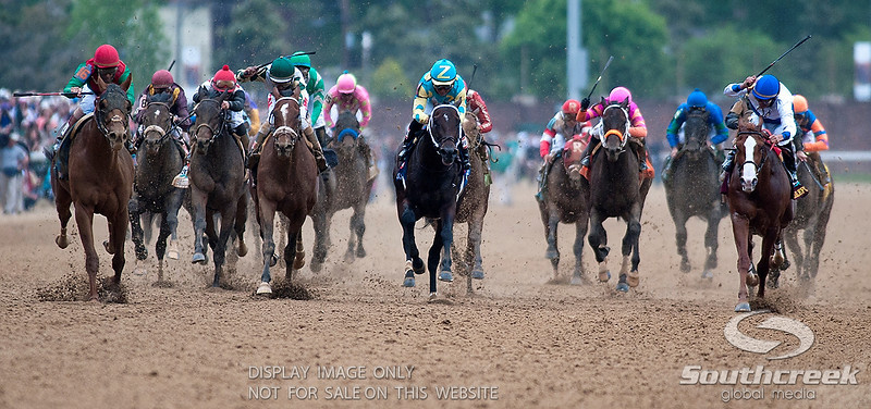 Jockey John Velazquez (16) aboard Animal Kingdom comes from the outside down the stretch to win the 137th running of the Kentucky Derby  at Church Hill Downs in Louisville,KY. Animal Kingdom won in front of a record crowd of 164,858.