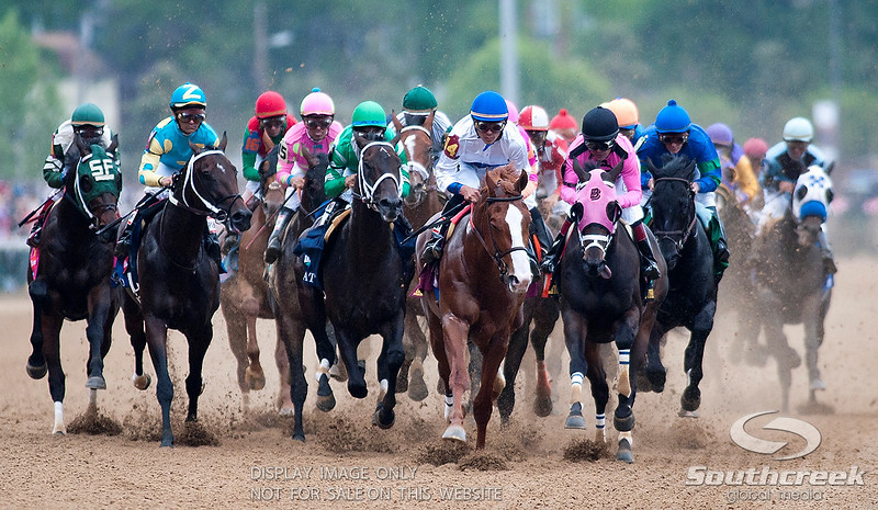 Jockey John Velazquez (16) aboard Animal Kingdom sits in the back on the first turn before winning the 137th running of the Kentucky Derby  at Church Hill Downs in Louisville,KY. Animal Kingdom won in front of a record crowd of 164,858.