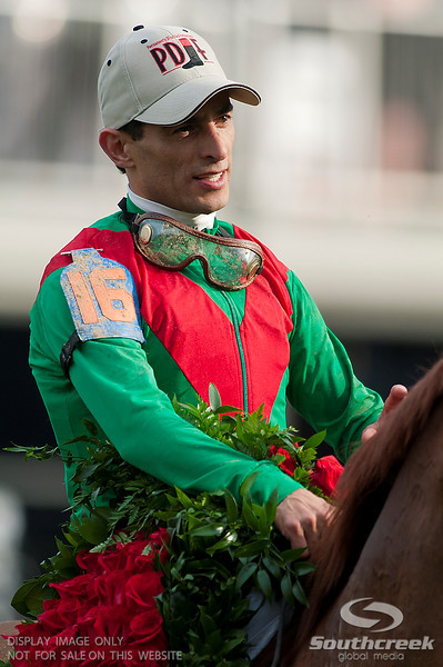 Jockey John Velazquez (16) aboard Animal Kingdom after he won the 137th running of the Kentucky Derby before a crowd of 164,858 at Church Hill Downs in Louisville,KY.