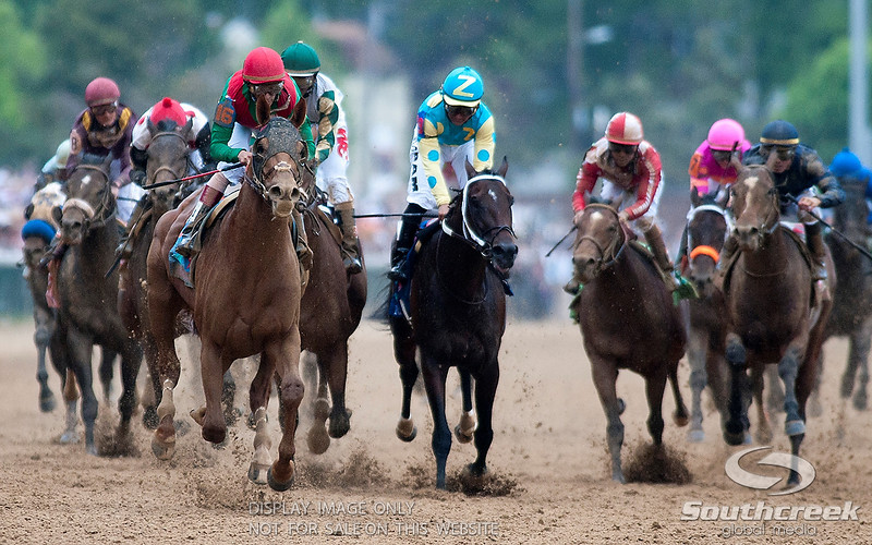 Jockey John Velazquez (16) aboard Animal Kingdom crosses the finish line to win the 137th running of the Kentucky Derby before record crowd of 164,858 at Church Hill Downs in Louisville,KY.