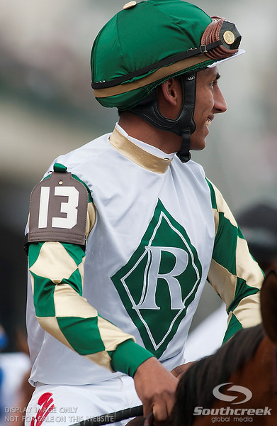 Jockey Rajiv Maragh (13) aboard Mucho Macho Man prior to the 137th running of the Kentucky Derby  at Church Hill Downs in Louisville,KY. Animal Kingdom won in front of a record crowd of 164,858.