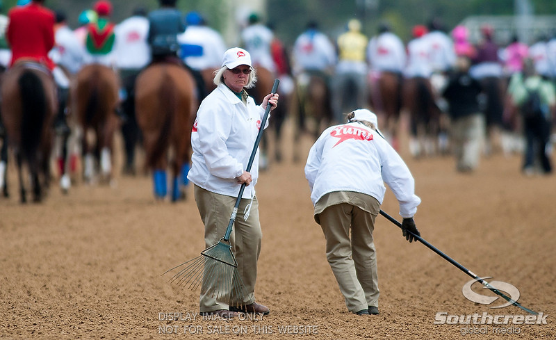 Workers rake the track prior to the 137th running of the Kentucky Derby  at Church Hill Downs in Louisville,KY. Animal Kingdom won in front of a record crowd of 164,858.