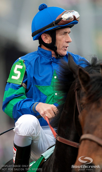 Jockey Kerwin Clark (5) aboard Decisive Moment prior to the 137th running of the Kentucky Derby  at Church Hill Downs in Louisville,KY. Animal Kingdom won in front of a record crowd of 164,858.