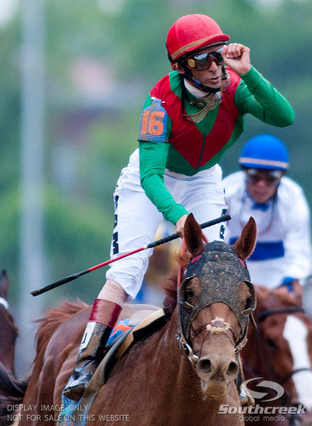 Jockey John Velazquez (16) aboard Animal Kingdom raises his fist as he wins the137th running of the Kentucky Derby before a crowd of 164,858 at Church Hill Downs in Louisville,KY.