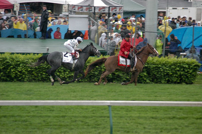 Woodford Reserve Turf Classic winner General Quarters with Robby Bejarano is picked up by the outrider