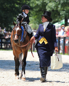 "Leadline Ages 1-3, Upperville 2012.  Devon Zebrovious leading Sydney Pemberton atop ""Just Dessert."""