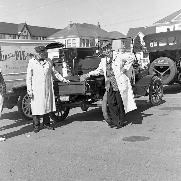 Horseless Carriage Club members pose for a picture near the Eureka Inn (background). This four-day gathering took place in August 1965. Some 300 antique car owners -- many decked out in old-fashioned clothing -- attended the event. (Times-Standard file photo)