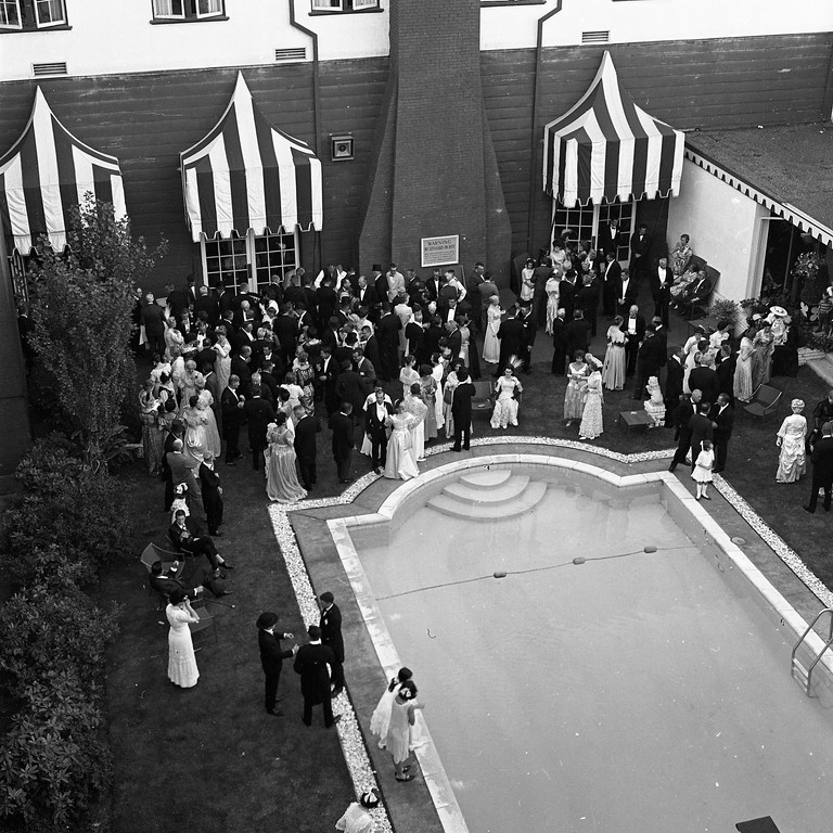 . The Eureka Inn\'s swimming pool faintly reflects guests dressed in styles dating back to the turn of the century as members of the Horseless Carriage Club of America gather for the last time after their four-day tour of Humboldt County. Some 300 antique automobile owners attended the vintage car touring event. (Times-Standard file photo)