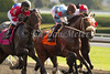 Came To Believe with Rosie Napravnik (black cap), Top Priority with Joe Rocco (brown cap) and Tiu with Alan Garcia (red cap) pass the stands for the first time in the 5th race at Keeneland. 10.04.2013