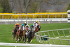 New Wave with Alan Garcia leads the field out of the backstretch, eventual winner Appealing Cat with Edgar Prado (green cap, outside) in the 6th race at Keeneland Race Course. 04.12.2013
