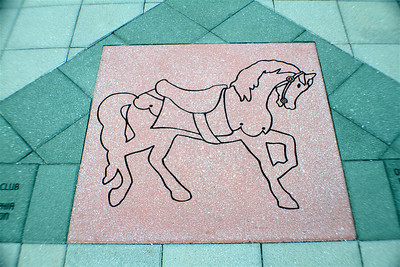 Carousel horse inlaid in the bricks at the Please Touch Museum in Philly, PA