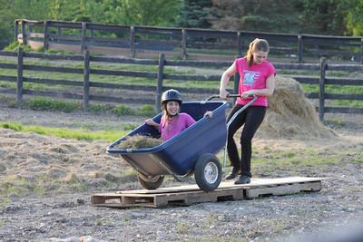 Helper In a Wheelbarrow game. Photograph courtesy of Lisa Homa.