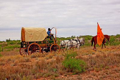John Deere wagon and rider with NM state flag.