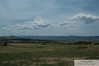 View from the pasture down the whole Front Range with Pike's Peak far in the distance.