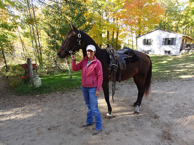 Laura and one of her horses, Willow.