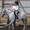 Casey riding Diamond in a show at Greylyn Farm.