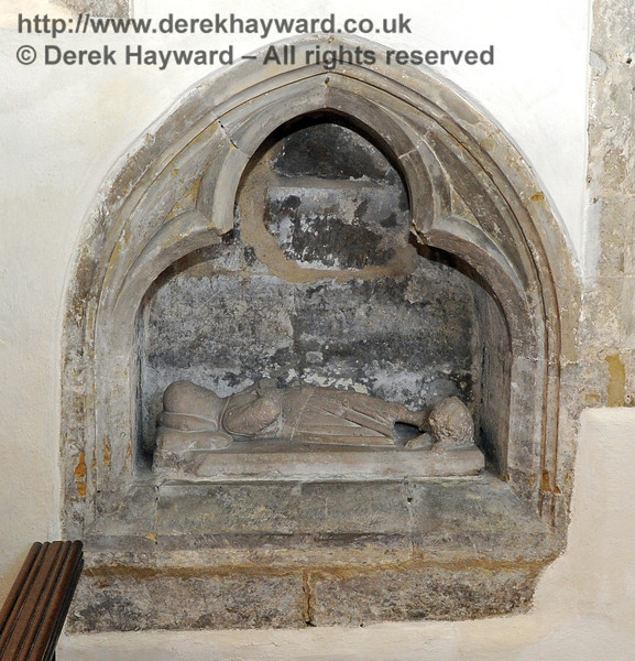 "To the left of the high altar is a ""little crusader"" effigy which is probably of Richard de Cahaignes who died in 1270 in the Crusades and whose heart encased in silver may lie below.  Horsted Keynes is where the Cahaignes family, who came to England with William the Conqueror and built St Giles, kept their horses.  The village has a link with Cahagnes in France.  <br /> <br /> St Giles Church, Horsted Keynes 06.04.2013  6640"