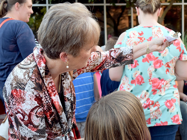 Carol Mitchem, left, of Clarkesville, TN, releases a butterfly with her grandaughter, Vera Dillingham, Thursday in the HSHS St. Anthony's Memorial Hospital Healing Garden. Kaitlin Cordes photo
