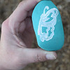 A rock decorated with a hand-painted butterfly is shown. These rocks were given to attendees of the butterfly release as a reminder of their loved ones. Kaitlin Cordes photo