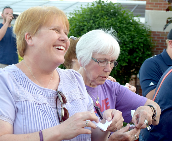 Donna McDevitt-Jones, left, of Altamont and Ann Platt, right, of Effingham open the containers in which their butterflies were held at the butterfly release Thursday. Kaitlin Cordes photo